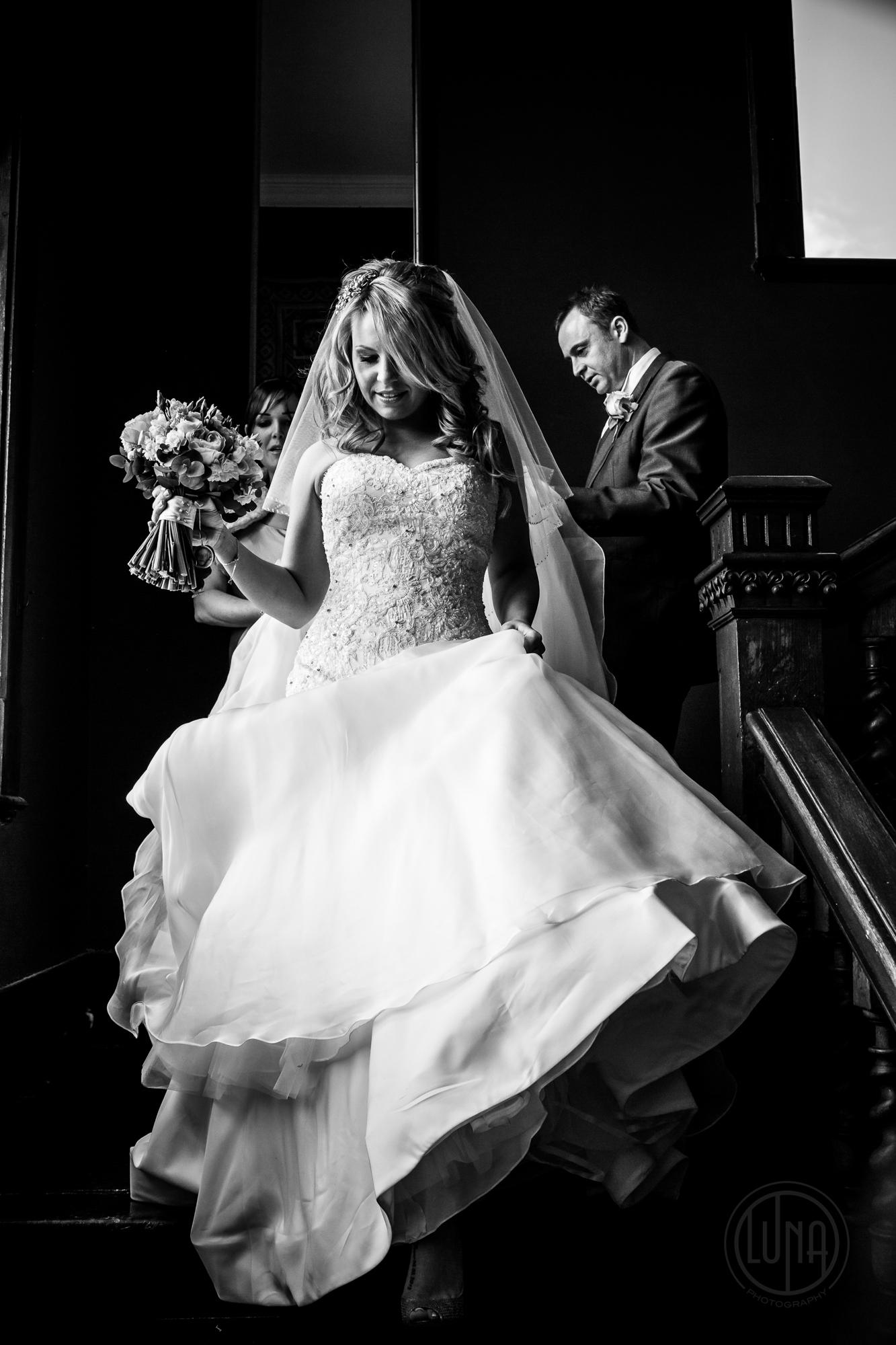 bride walking down stairs at huntsham court