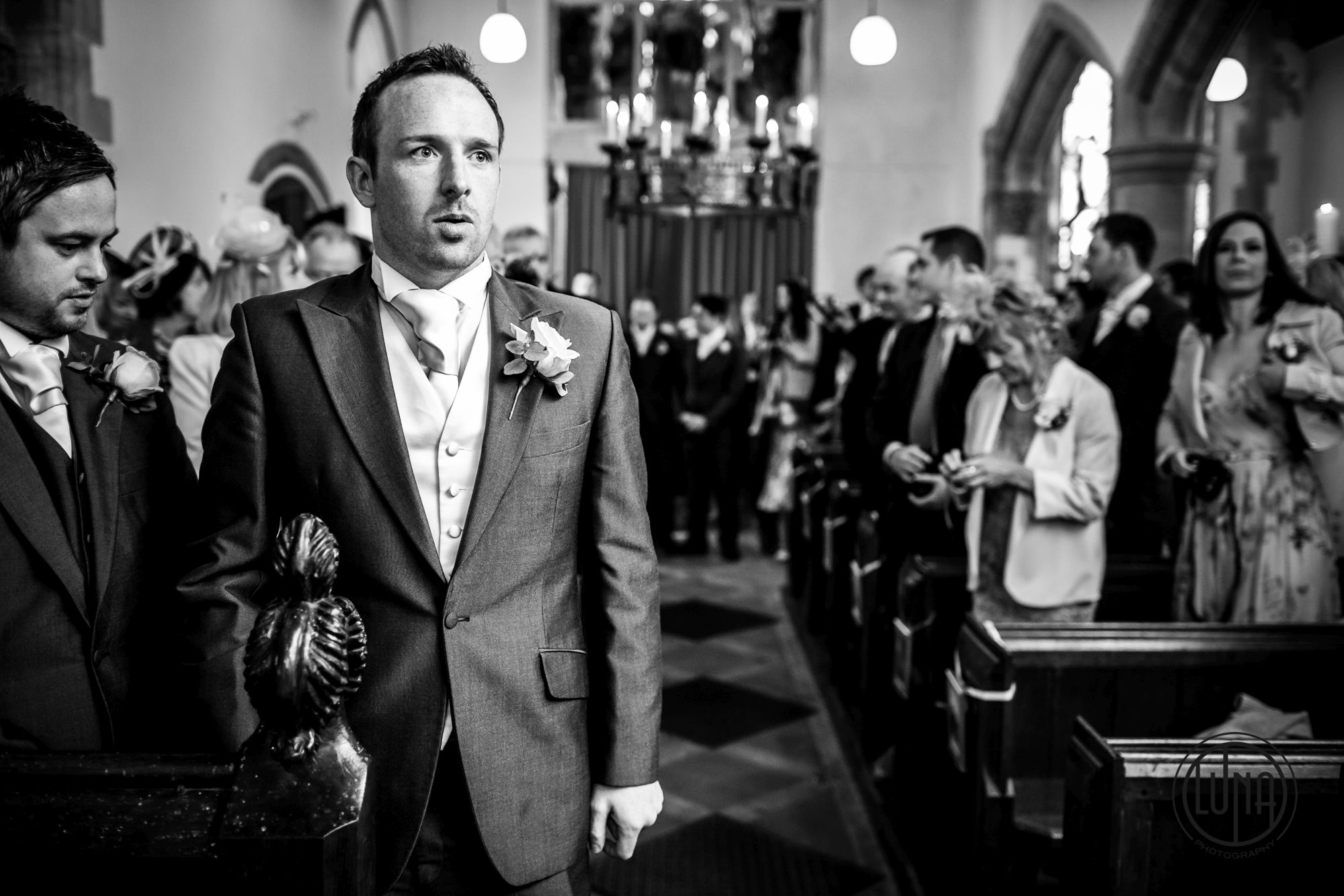 groom waits nervously for bride at huntsham court
