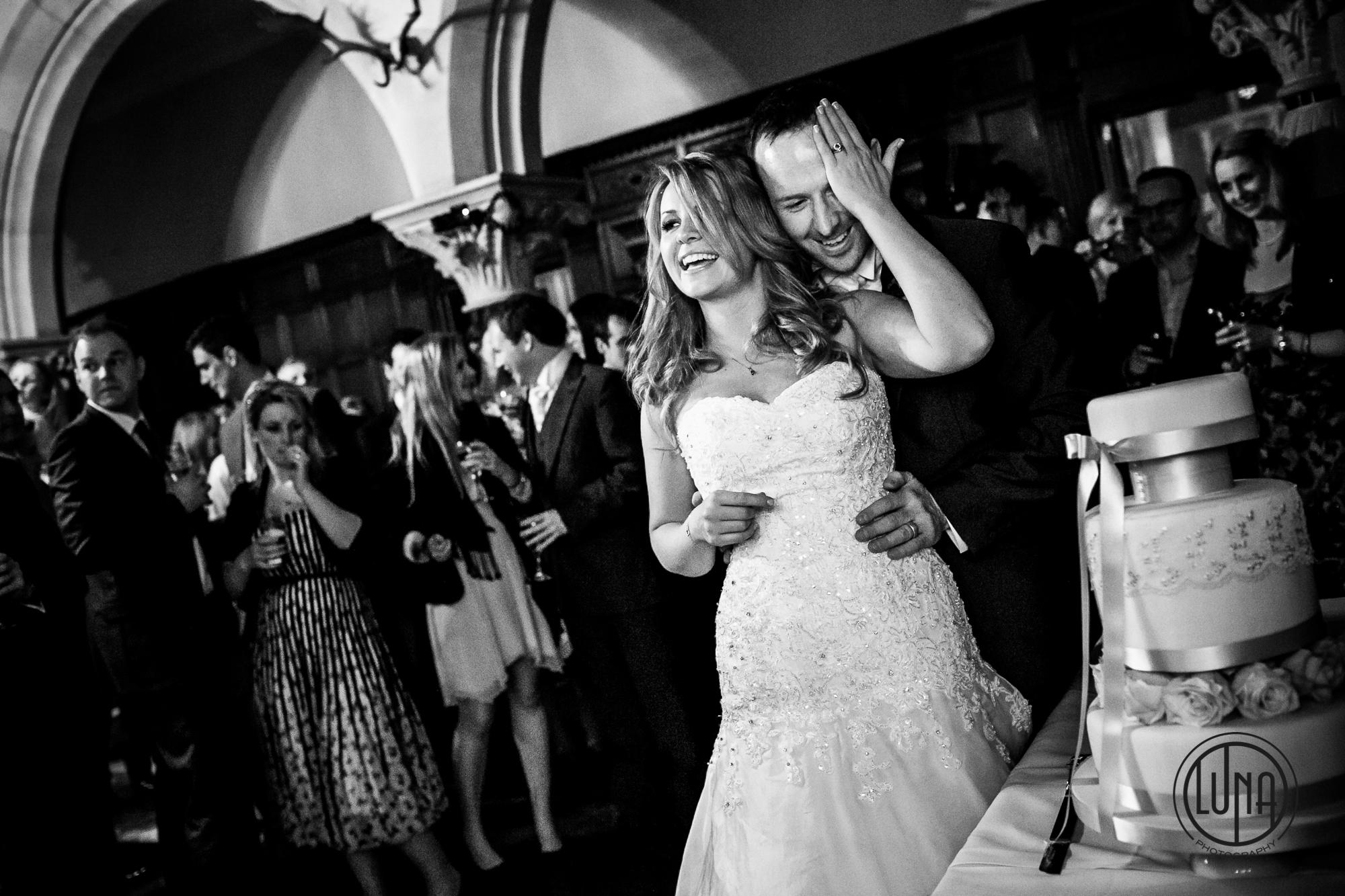 funny cake cutting moment at wedding in huntsham court devon
