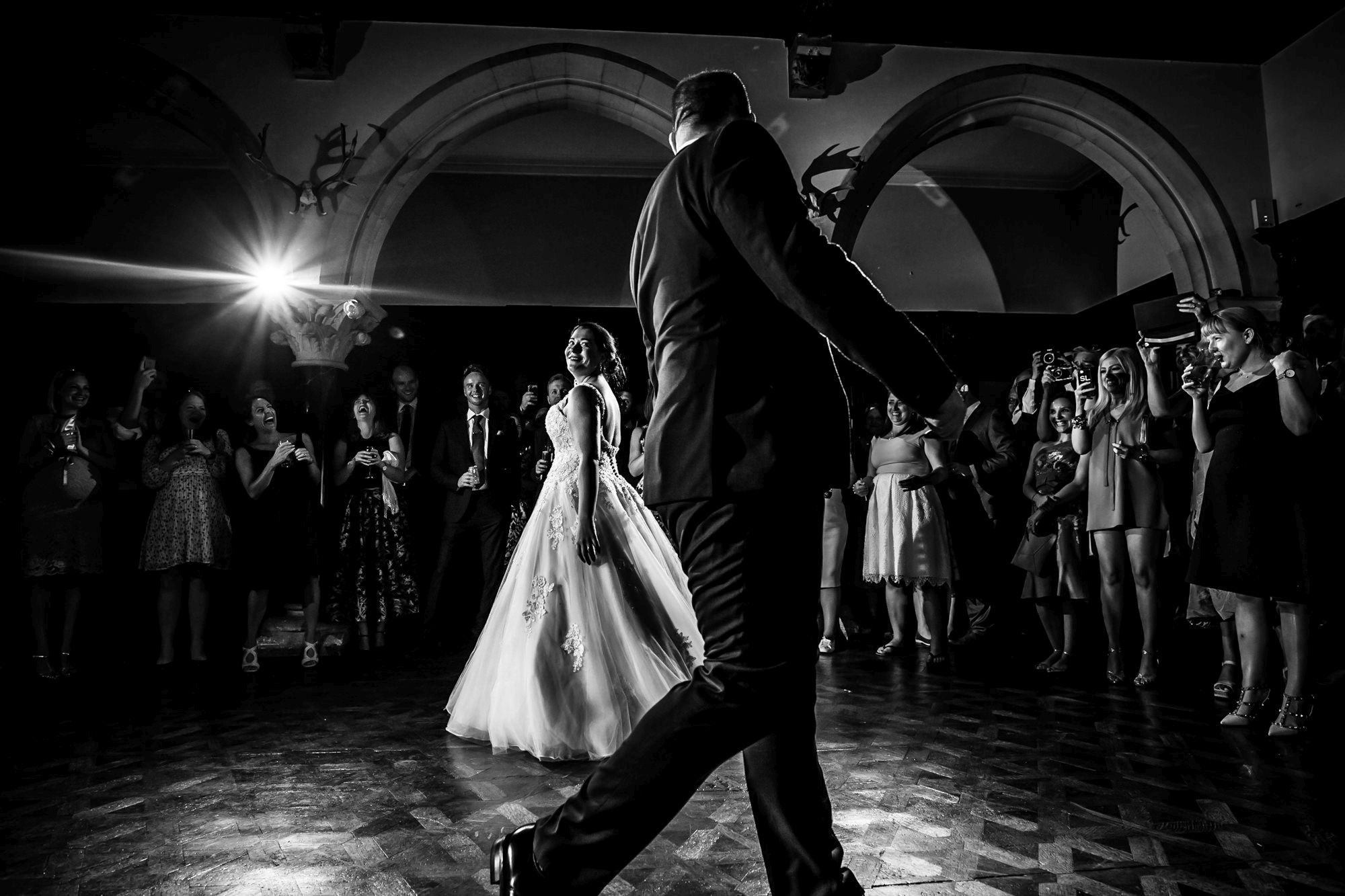 black and white image of bride and groom doing first dance at huntsham court