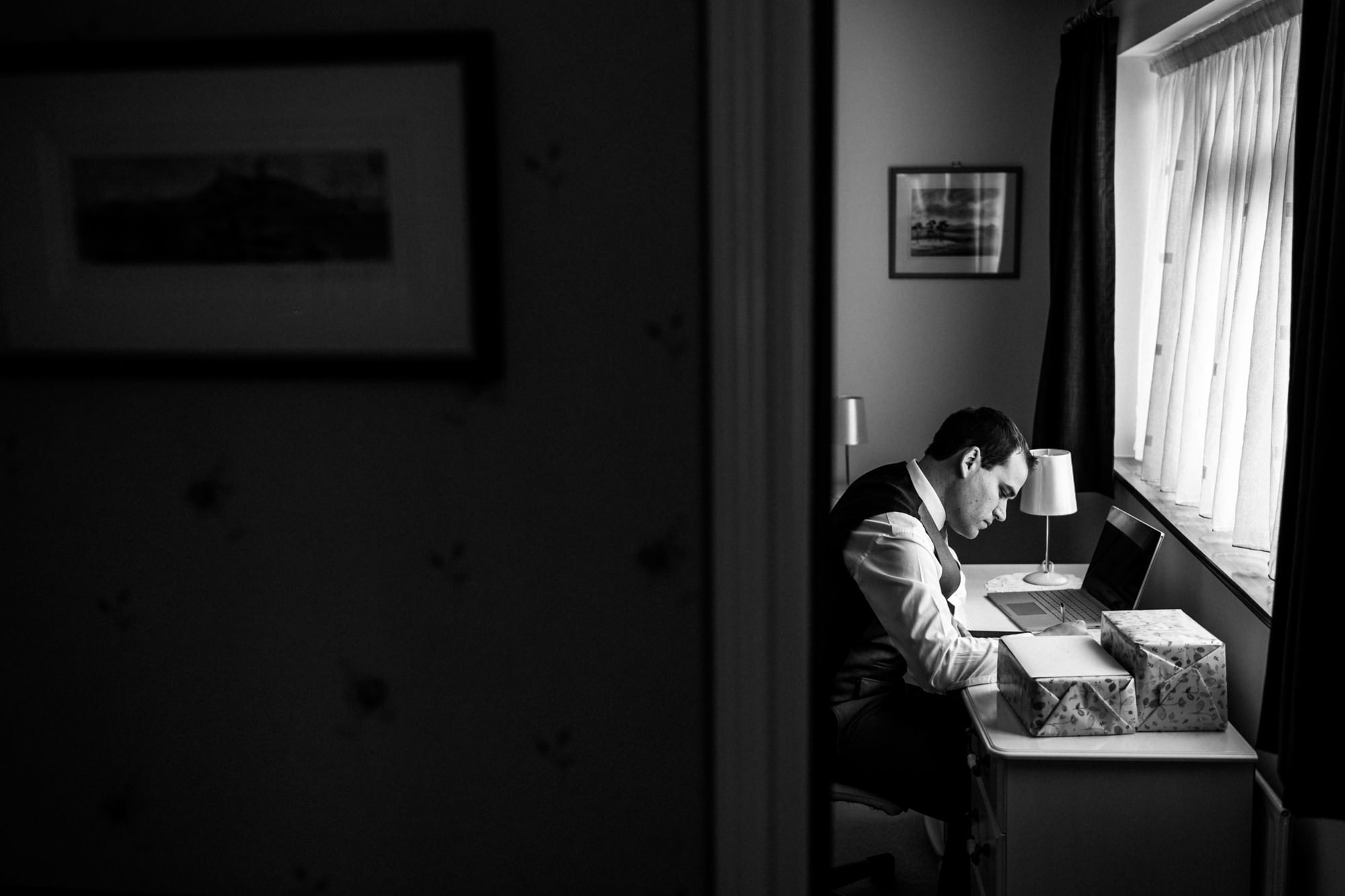 groom writing speech, black and white image