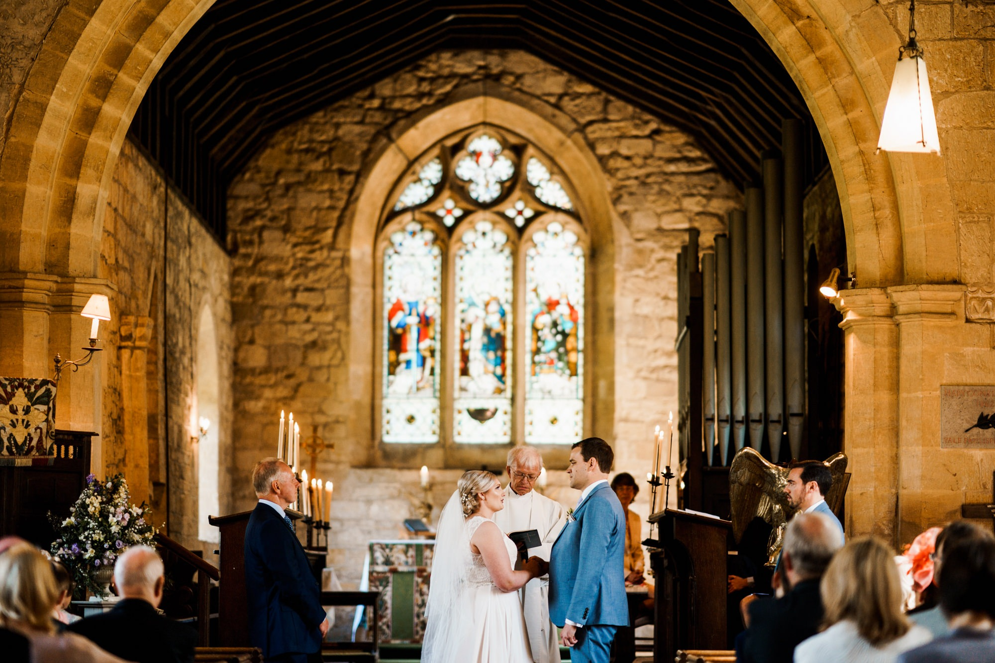 wedding ceremony in church viewed from back