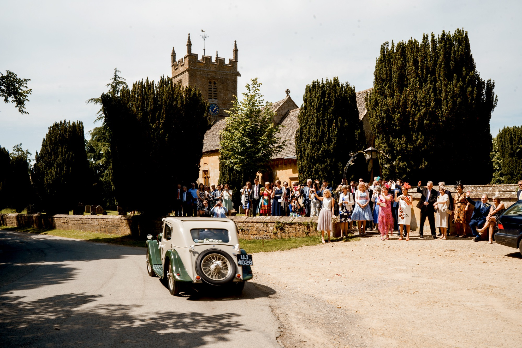 vintage car leaving church wedding