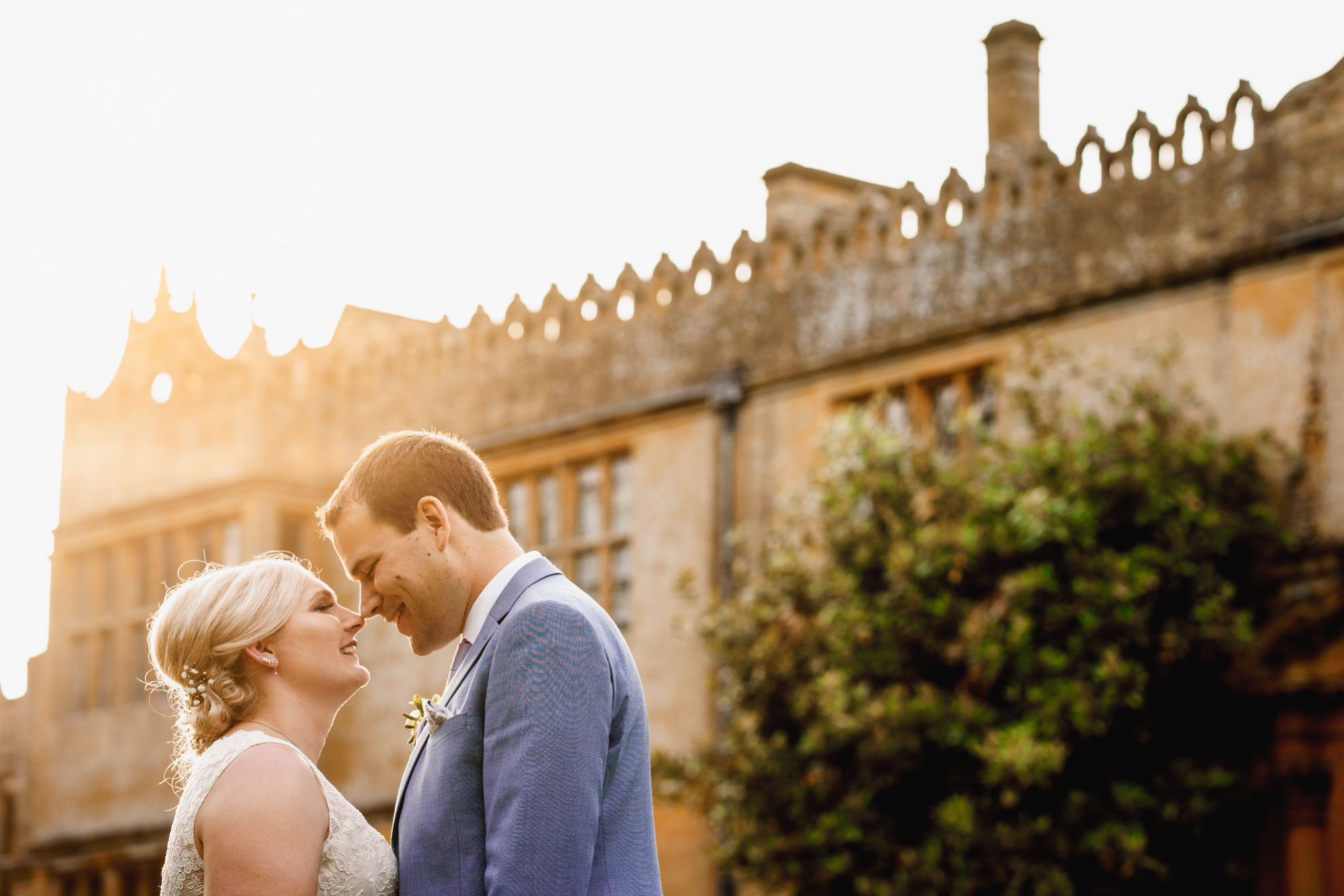 bride and groom face each other in lovely light at stanway house