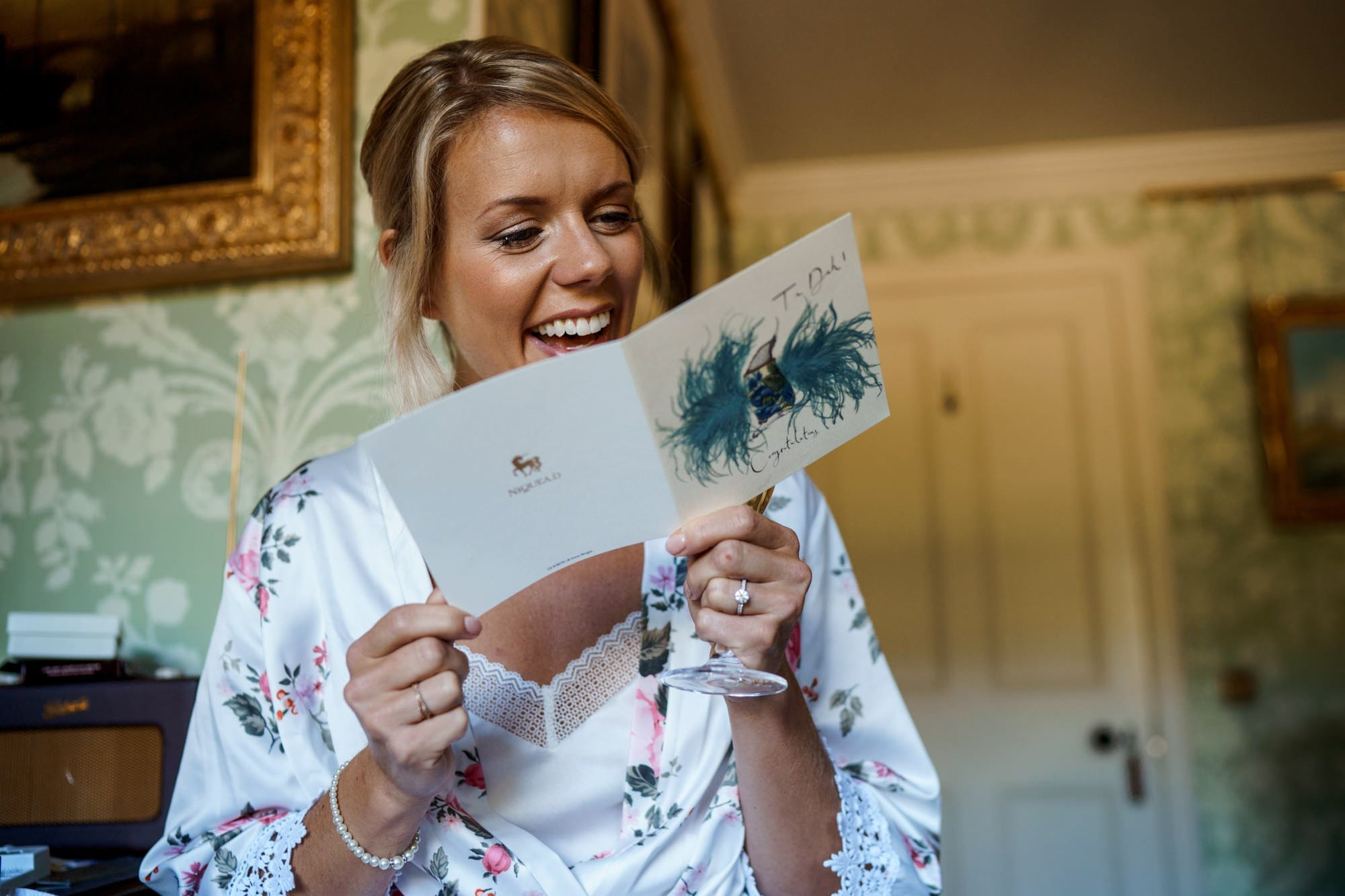 bride reading card on morning of wedding at aldourie castle