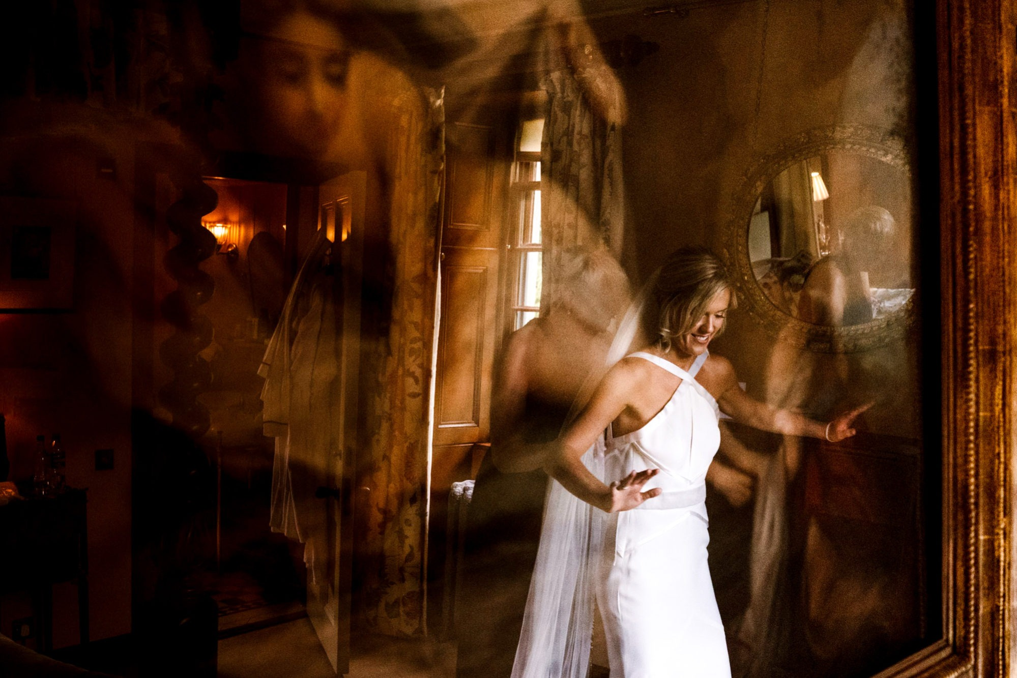 bride in reflection at aldourie castle wedding