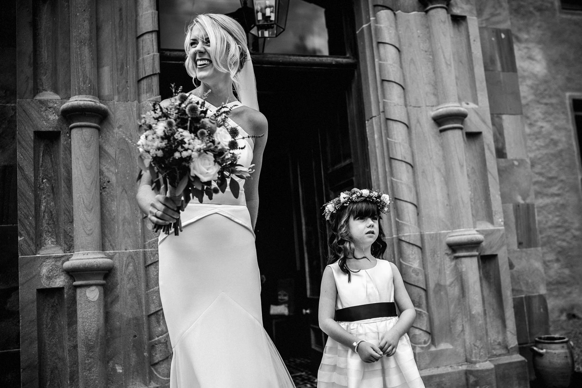 bride and flower girl leaving wedding at aldourie castle